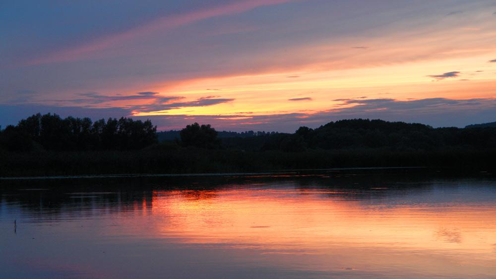 Mecklenburgische Seenplatte paddeln Sonnenuntergang 5 Tipps für einen Kurzurlaub in Deutschland mit Kindern